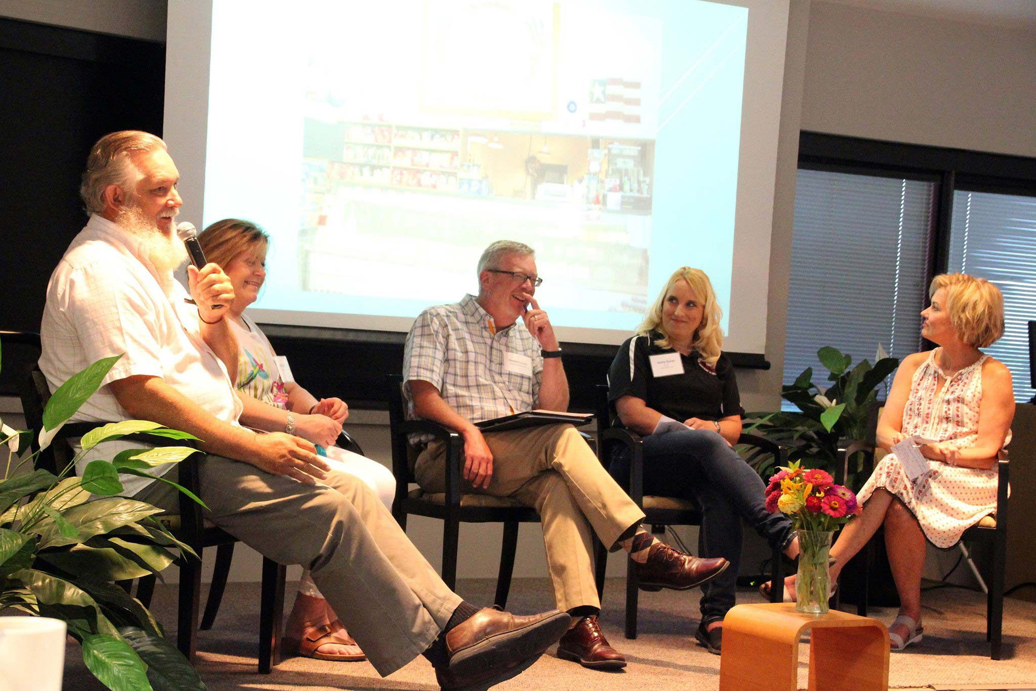 A panel of grocers at the 2017 Healthy Eating Rural Opportunities Learning Collaborative: Fred and Vali Smith (left) of Tipton Grocery in Tipton, pop. 210, and Jenny Osner of Hired Mans Grocery & Grill Inc in Conway Springs, pop. 1,272 (second from right). Debra Nelson from Garden of Eden Little River, pop. 557 (right). David Procter of Rural Grocery Initiative is in the center. —Photo by Phil Cauthon