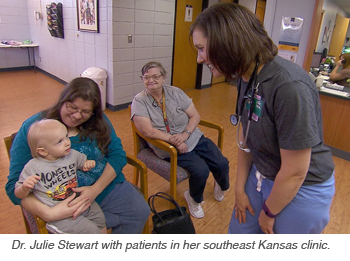 Dr. Julie Stewart with patients in her southeast Kansas clinic.