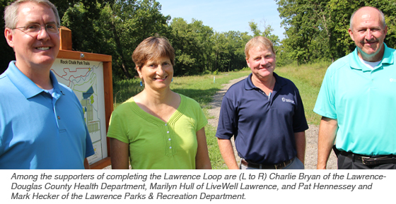 Among the supporters of completing the Lawrence are (L to R) Charlie Bryan of the Lawrence-Douglas County Health Department, Marilyn Hull of LiveWell Lawrence, and Pat Hennessey and Mark Hecker of the Lawrence Parks & Recreation Department.