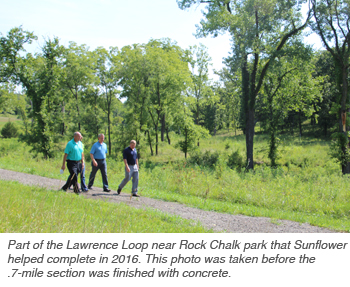 Part of the Lawrence Loop near Rock Chalk park that Sunflower helped complete in 2016. This photo was taken before the .7-mile section was finished with concrete.